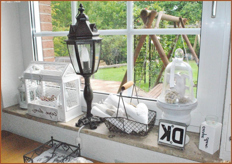 Stilvolle Deko Wohnzimmer Fensterbank